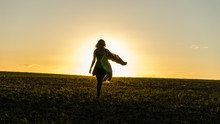 Girl Walking Into The Sunset