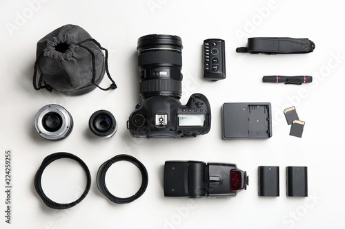 Obraz Flat lay composition with photographer's equipment and accessories on white background - fototapety do salonu