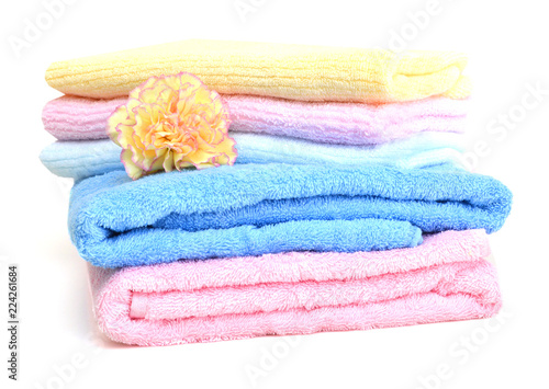 Fotografie, Obraz  colorful towels and carnation flower isolated on white