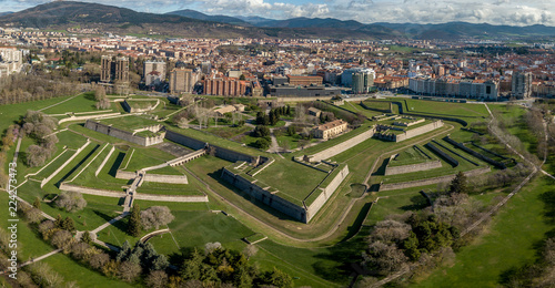 Fotografering Aerial view of Pamplona citadel with blue clodu sky background on a spring morni