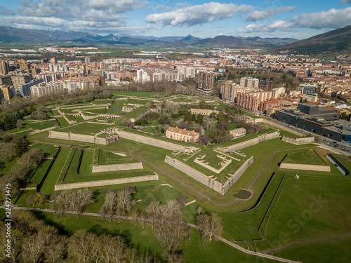 Tablou Canvas Aerial view of Pamplona citadel with blue clodu sky background on a spring morni