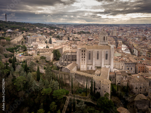 Poster Aerial panorama of medieval Girona in Catalonia with cathedral, fortifications and cloudy sky