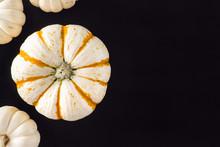 Orange And White Heirloom Pumpkins On Black Table