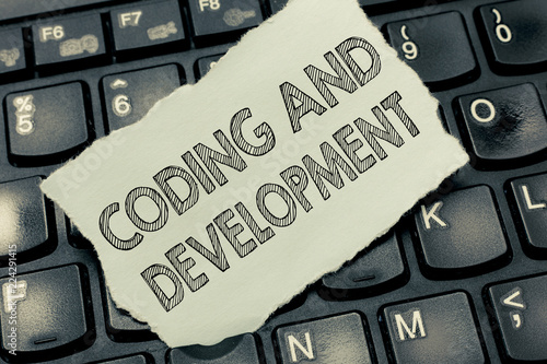 Photo  Conceptual hand writing showing Coding And Development