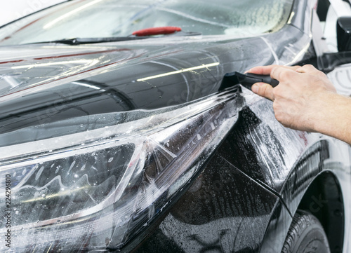 Tablou Canvas Car wrapping specialist putting vinyl foil or film on car