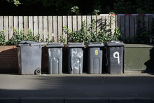 Black Wheelie Bins In A Row On...