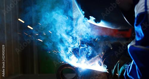 Metal worker welding in metal industry factory
