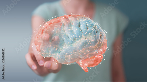 Businesswoman using digital 3D projection of a human brain 3D rendering