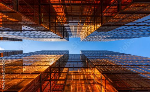 golden-building-with-blue-sky-windows-glass-of-modern-office-skyscrapers-facade-design-architecture-exterior-for-cityscape-background