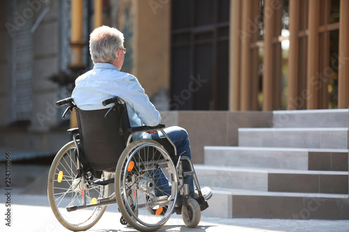 Photo  Senior man in wheelchair near stairs outdoors