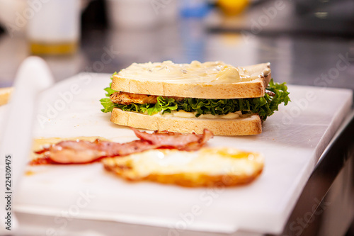 Chef making sandwich with fresh ingredient.Delicious nutrition