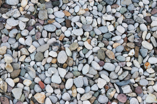Fine pebbles of a gray shade. Beach ground. Natural material for design, decoration and construction. Sanded granite and hard minerals. Geology and minerals. Tutorial.