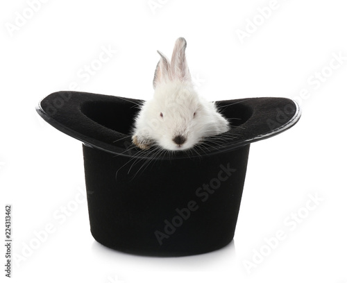 Foto Magician hat with cute rabbit on white background