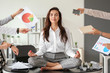 Leinwanddruck Bild - Businesswoman with a lot of work to do meditating in office