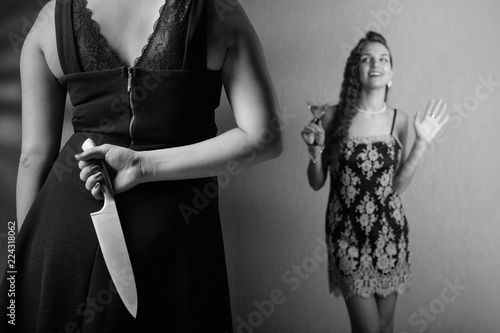 Fotografie, Obraz  Insidious woman with knife in her hand and her rival.
