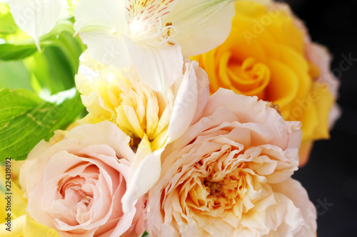 Foto op Canvas Bloemen bouquet of roses wite and yellow on the sun