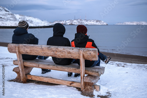 Fotobehang Poolcirkel People on the bench in Teriberka, Murmansk Region, Russia