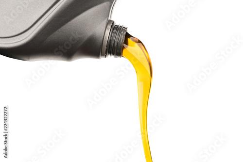 Fototapeta Pouring oil lubricant motor car from gray bottle on isolated white background obraz