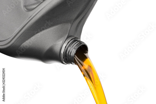 Cuadros en Lienzo Pouring oil lubricant motor car from gray bottle on isolated white background
