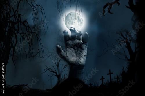 Keuken foto achterwand Begraafplaats Hand rising from the ground in the cemetery on Halloween Concept.