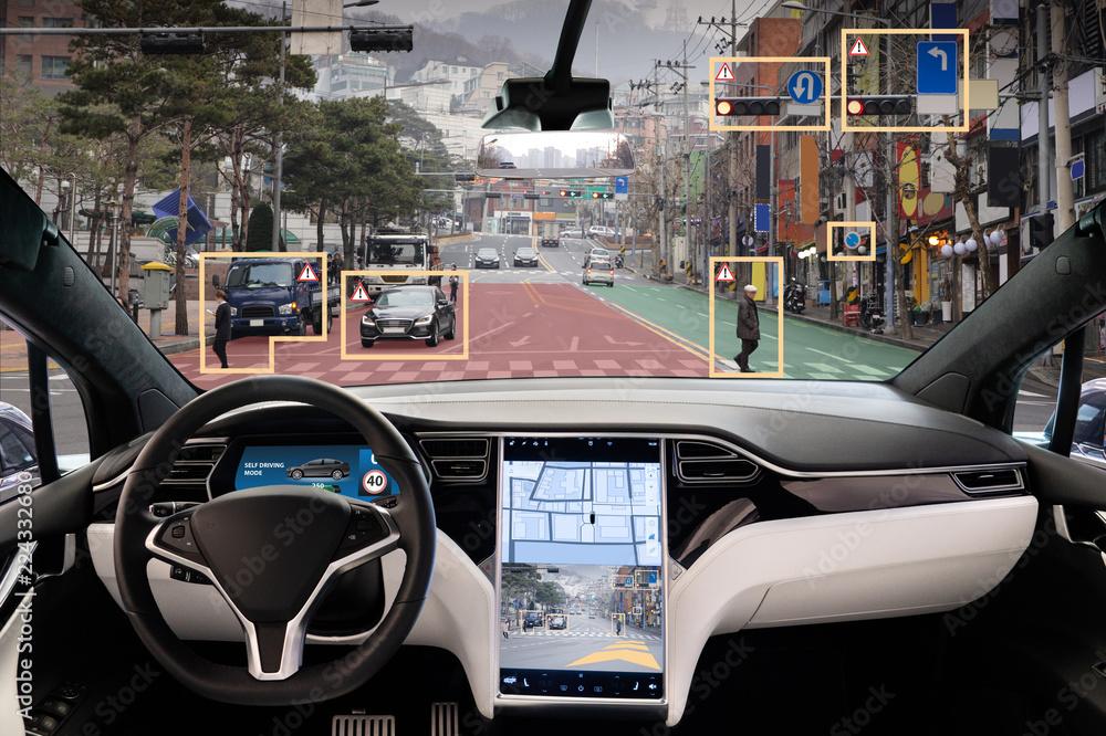Fototapeta Autonomous car with HUD (Head Up Display). Self-driving vehicle on city street