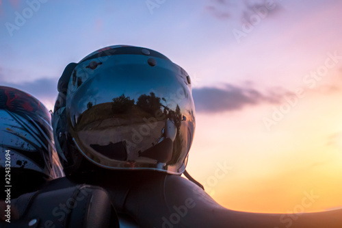 Acrylic Prints Winter sports Motorcycle helmet on sunset background