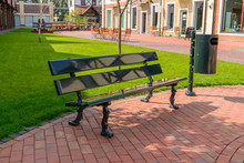 Empty Bench And Trash Can On A...