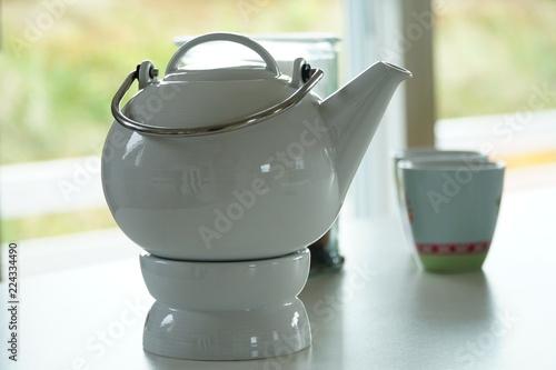 Teekanne auf Stövchen