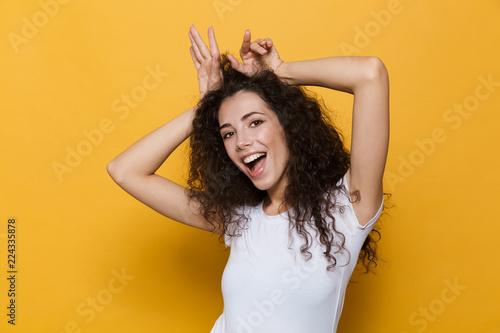 Fototapeta Cute young woman posing isolated over yellow background. obraz na płótnie