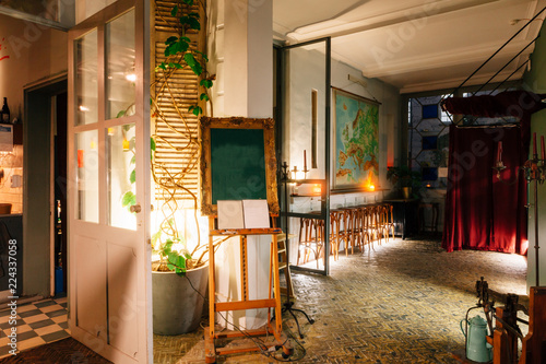 interior of a cozy old European style cafe with stools and