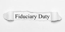 Fiduciary Duty On White Torn Paper