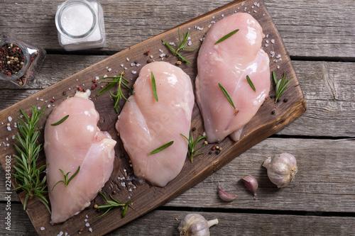 Raw chicken breast ( fillet ) with ingredient
