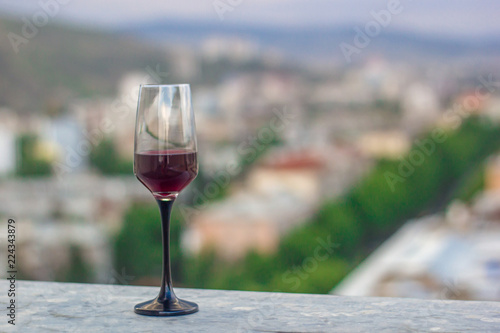 one glasses of wine on the roof of the town