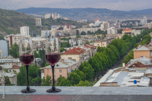two glasses of wine on the roof of the town