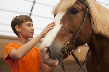Horse and teen boy - best friends