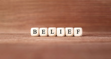 Word BELIEF Made With Wood Building Blocks