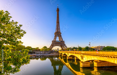 Poster Tour Eiffel View of Eiffel Tower and river Seine at sunrise in Paris, France. Eiffel Tower is one of the most iconic landmarks of Paris