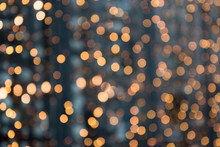 Christmas Abstract Background. Blurred Golden Garland Blur Bokeh, Defocused Pattern.