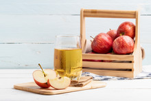 One Glass Of Apple Juice And Fresh Apple On White Background.