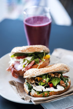 Breakfast Table. Sandwiches And Red Smoothie With A Magazine. Healthy Meal Conception.