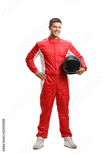 Racer standing and holding a helmet