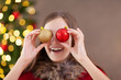 canvas print picture - christmas time, teenage girl with  christmas balls