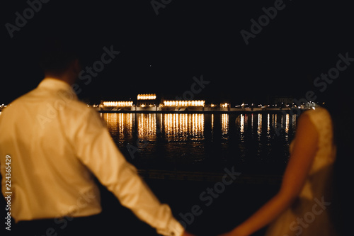 Fototapeta Luxury married wedding couple, bride and groom posing in luxury city obraz na płótnie