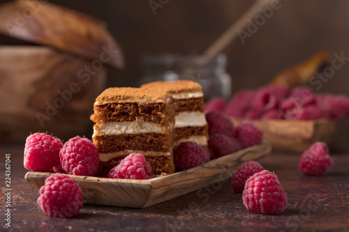 Foto op Canvas Dessert Layered honey cake with cream and raspberries.