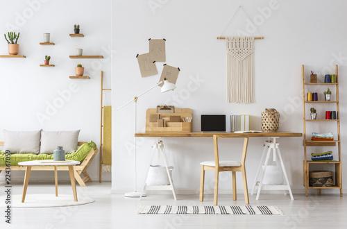 Fotografía  Real photo of a natural home office interior desk organizer, macrame on a wall,