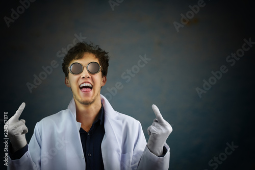 Fotografia, Obraz  Laughing male scientist giving you the fingers.