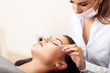 canvas print picture - Adult woman having eyelash extension in professional beauty salon