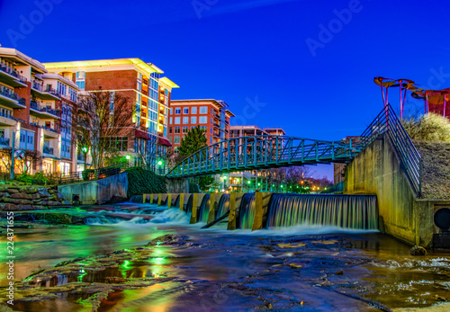 Fotografie, Obraz Reedy River and RiverPlace Bridge in Downtown Greenville, South Carolina, USA