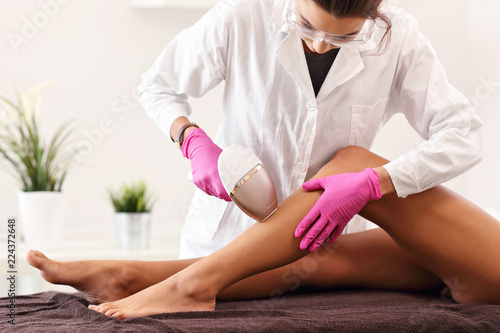 Fotografie, Obraz Adult woman having laser hair removal in professional beauty salon