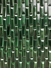 Green Geometric Tile Wall Background With Room For Text